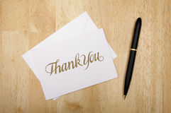 Thank You Note Card and Pen. On Wood Background stock photography