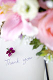 Thank you note. Floral in the foreground with thank you note Royalty Free Stock Photo