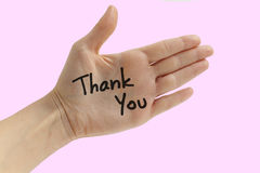 THANK YOU NOTE. THANK YOU on hand over pink background Royalty Free Stock Image
