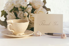 Thank you note with tea cup. And roses Royalty Free Stock Images