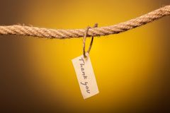 Thank you note tethered to the rope. Thank you note tethered to the rope stock photo