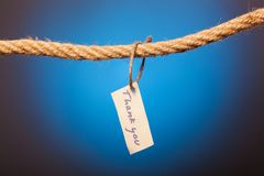 Thank you note tethered to the rope. Thank you note tethered to the rope royalty free stock images