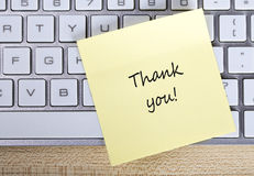Thank You Note. Top view of Thank You sticky note pasted on the keyboard Royalty Free Stock Images