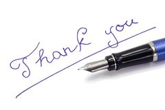 Thank you note on white background. By blue ink Stock Photography
