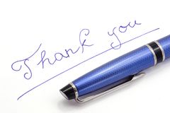 Thank you note on white background. By blue ink Royalty Free Stock Photos