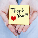 THANK YOU NOTE. Woman hand holding THANK YOU note royalty free stock photos