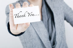 THANK YOU NOTE. Woman in suit holding THANK YOU note card Royalty Free Stock Photography