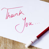 THANK YOU NOTE. THANK YOU on wooden table Stock Photos