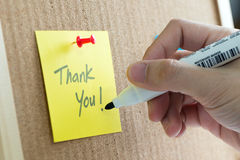 Thank you note. Thank you yellow note on cork notice board Royalty Free Stock Image