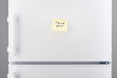 Thank you note on yellow sticky paper on white refrigerator. Thank you note on light yellow sticky paper on white refrigerator door Stock Photos