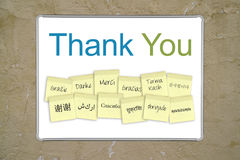 Thank you notes. A whiteboard with the words thank you in 13 different languages. Outer and inner clipping paths for the whiteboard included Royalty Free Stock Photography