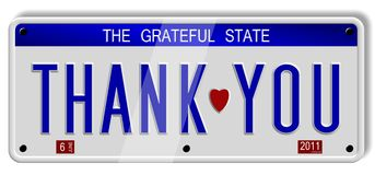 Thank you number plates. White car number plates spelling thank you on the white background Royalty Free Stock Image