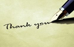Thank you on old paper texture. Pen writing thank you on old paper texture Royalty Free Stock Image