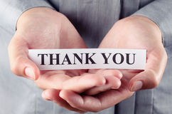 Thank you. Piece of paper with the words Thank you in the woman's palms Stock Photography