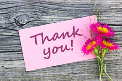 Thank you. Pink flowers and pink card with lettering Thank you Stock Photography