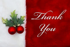 Thank You. A plush red stocking with a Mistletoe Ornament and words Stock Photos