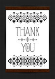 Thank you print in wooden frame on subtle background. Stock Photos