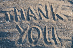 Thank you in sand. Thank you written in sand Royalty Free Stock Photography
