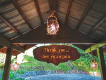 Thank you and see you again signage on wooden hanging top. royalty free stock images
