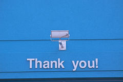Thank you sign. On blue Royalty Free Stock Image