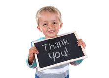 Thank you sign. Young child holding thank you sign standing against white background