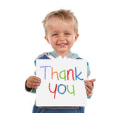 Thank you sign. Child holding a crayon thank you sign standing against white background Royalty Free Stock Image