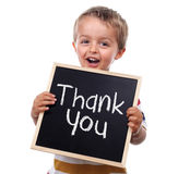 Thank you sign. Child holding a thank you sign standing against white background Royalty Free Stock Image