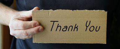Thank you. Sign made of cardboard with the words Thank you Stock Image