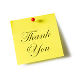 Thank you. Sign on note paper over white background Stock Photography