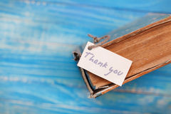 Thank you sign on old book - vintage style. Thank you sign on the old book - vintage style Stock Images