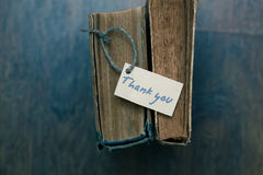 Thank you sign on old book - vintage style.  Stock Photography
