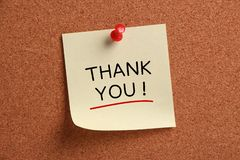 Thank You. Sticky note pinned on corkboard Royalty Free Stock Photos