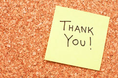 Thank you sticky note. Thank you; note on a yellow sticky paper on a cork memory board Royalty Free Stock Photos