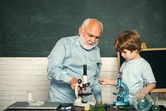 Thank You Teacher. A Biology demonstration. Tutoring. Old bearded teacher over green chalkboard background. World