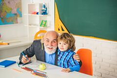 Thank You Teacher. Concept of a retirement age. Portrait of grandfather and Son in classroom. Educational process.