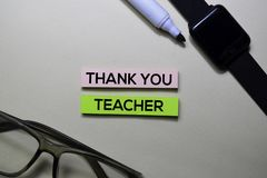 Thank You Teacher text on sticky notes  on office desk