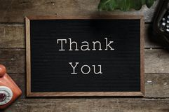 Thank You Text on Black and Brown Board Stock Images