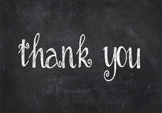 Thank you text on black chalkboard Royalty Free Stock Images