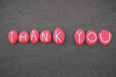 Thank you composed with red colored stone letters