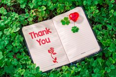Thank you text in notebook royalty free stock photography