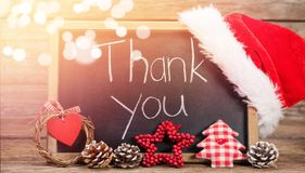 Thank you text on slate with decorations on wooden table Royalty Free Stock Image