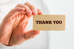 Thank You Text on Small Piece Wood Hold by Hand Stock Images
