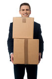 Thank you for timely delivery. Happy businessman carrying cardboard boxes stock photo