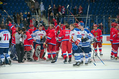 Thank you to the fans. MOSCOW - JANUARY 29, 2016: Russian and Finland National Team after a hockey game Russia vs Finland on World Legends hockey league, in VTB Stock Photo