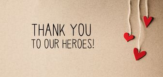 Thank You to Our Heroes message with small hearts
