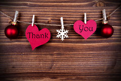 Thank You on Two Heart on a Line. The Words Thank You on two Heart with Christmas or Winter Decoration Hanging on a Line on Wooden Background, with Copy Space Royalty Free Stock Images