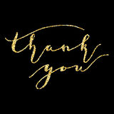 Thank you, type on Golden glitter sparkles background Royalty Free Stock Image