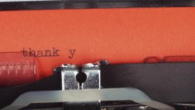 Thank you - typed on a old vintage typewriter. Printed on red paper. The red paper is inserted into the typewriter stock video footage