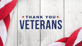 Thank You Veterans Text with American Flag Over White Wood Background. For Memorial Day and Veteran`s Day Holidays royalty free illustration