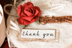 Thank you. On white scrap of paper on a gift box present background Stock Photography
